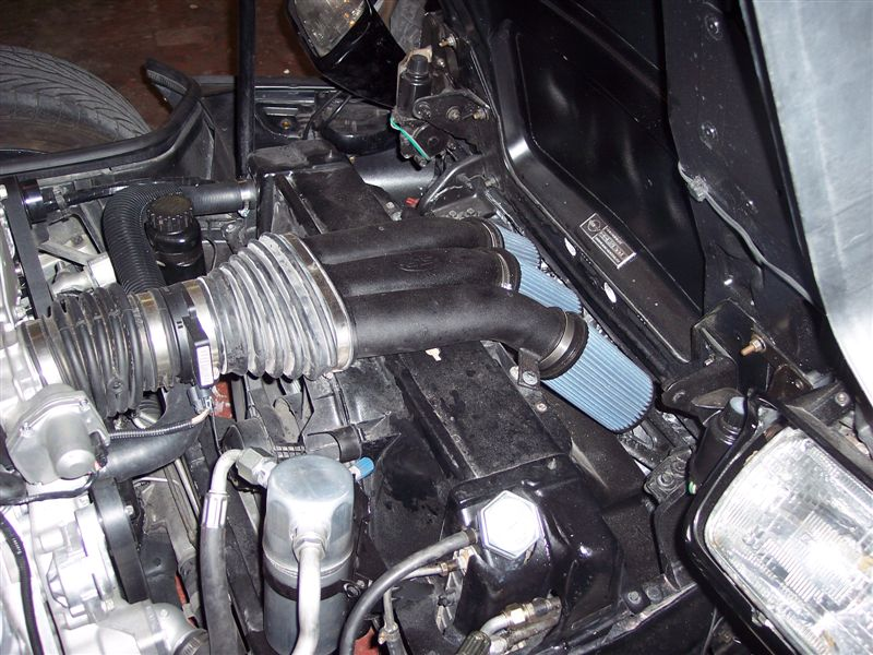 An aftermarket C5 air intake & air cleaner works fine to connect the LS2 to fresh air.