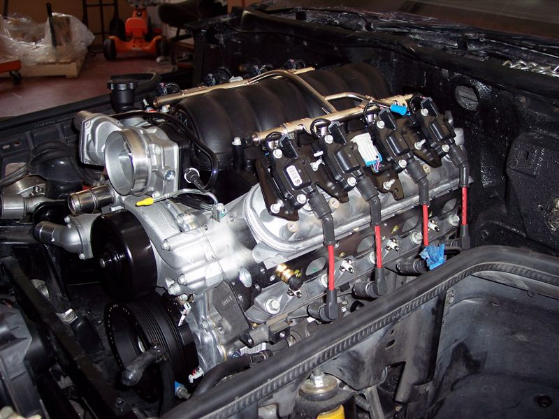 The LS2 looks like it belongs in the 85's engine bay.  Factory radiator hose positioning requires a trip to the local parts store for a look at what might work.