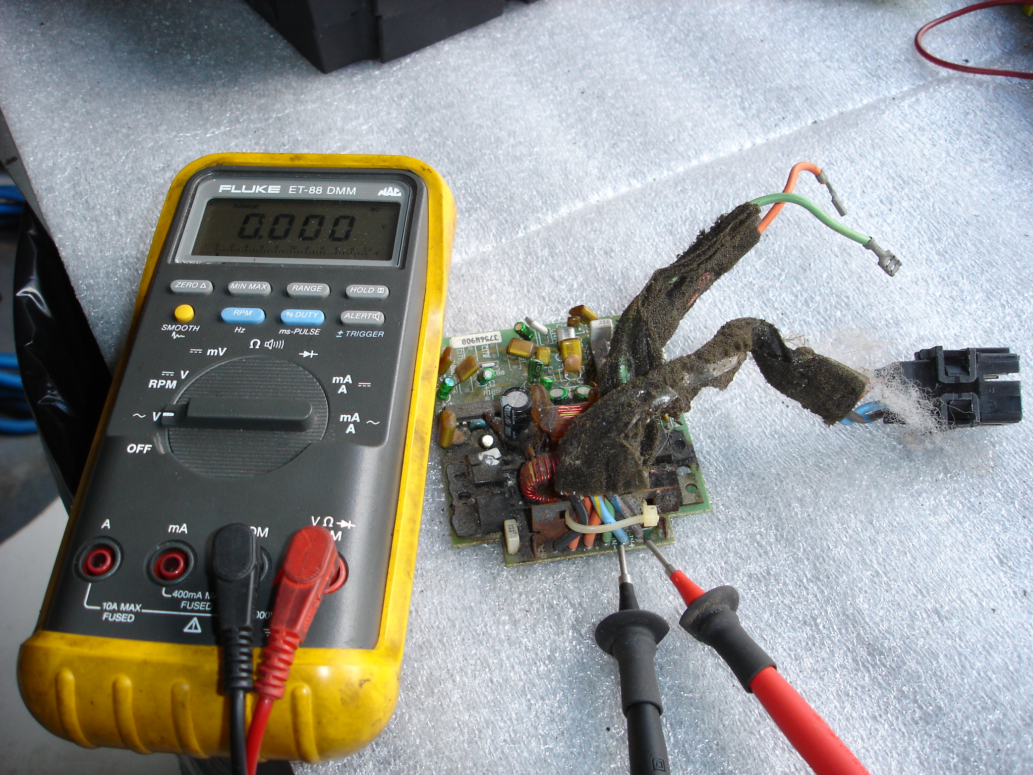 This is the setup required to check the amplifier for proper signal from  the radio. Connect a voltmeter set on low AC voltage to terminals C and D.  With the ...